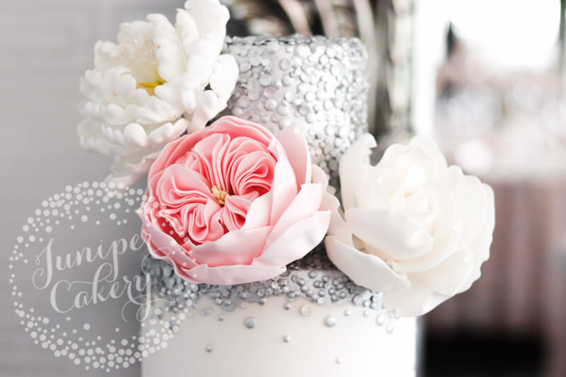 Pretty wedding cake with white and pink sugar flowers by Juniper Cakery