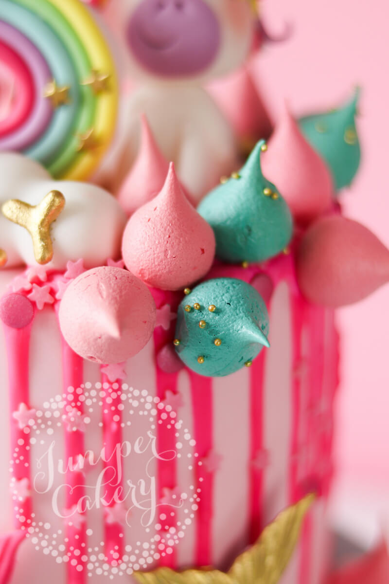 Bright meringue kisses on a unicorn and mermaid birthday cake by Juniper Cakery