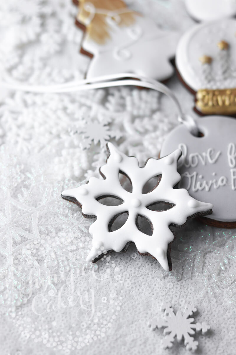 Pretty snowflake cookie for Olivia Burton by Juniper Cakery