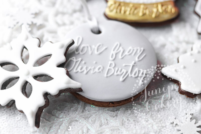 Adorable snow themed cookies made for Olivia Burton by Juniper Cakery