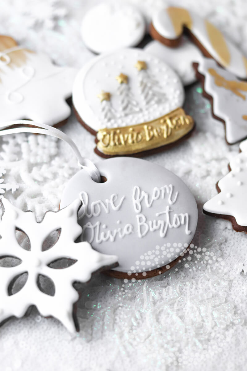 Olivia Burton snow globe biscuits by Juniper Cakery