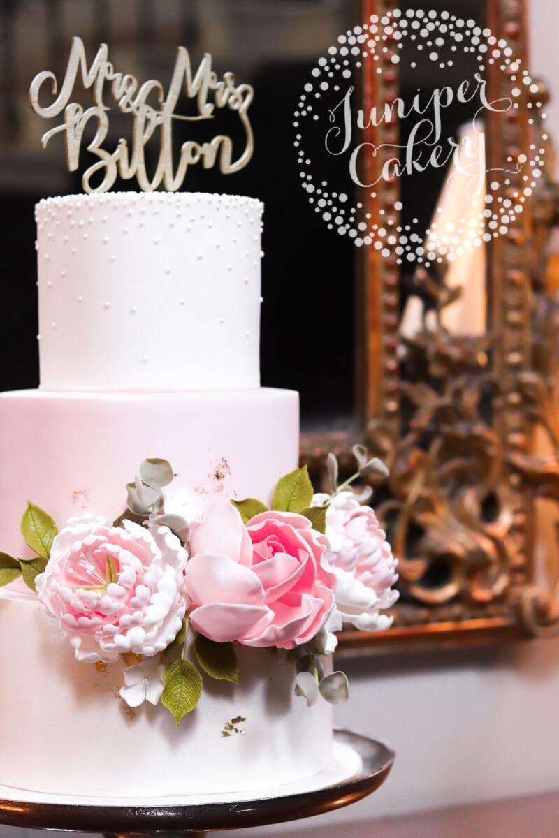 Blush floral Saltmarshe Hall wedding cake by Juniper Cakery