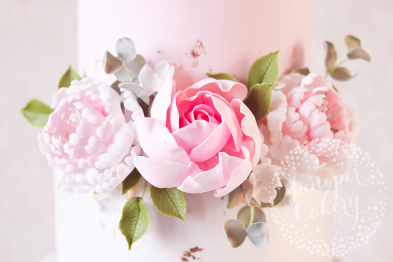 Blush floral wedding cake by Juniper Cakery