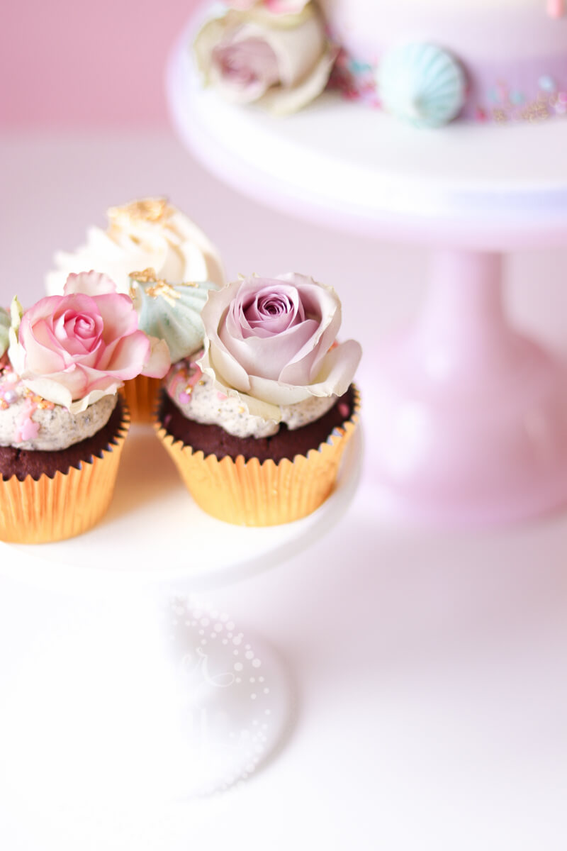 Pretty pastel cake and cupcakes by Juniper Cakery