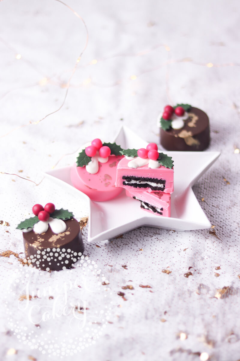 Pink Christmas pudding chocolate oreos by Juniper Cakery