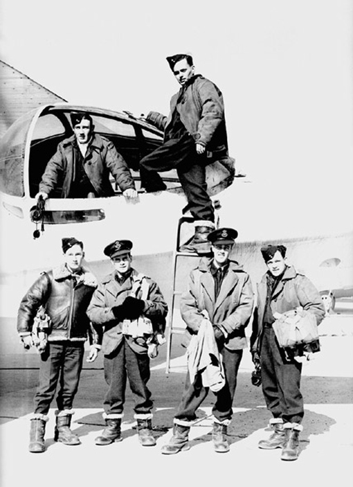 A Canso crew serving on maritime patrols along the Atlantic seaboard. In blister, Sergeant A. Skee, next to Leading Aircraftman L.D. Allgood. Standing from left to right, Warrant Officer Class 2 C.C. Hogleth, Flying Officer E.C. Snider, Flight Lieutenant J.W. Langmuir, Captain, and Flight Sergeant M.W. Paul.
