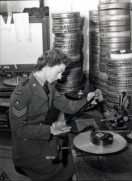 Sgt Margaret O. King, CWAC, editing movies at the Merton Park Studios film library, in London, December 19th, 1944.