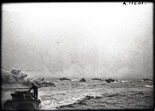 Landing crafts of the assault troops taking part in Operation Jubilee, Dieppe, August 19th, 1942. On the left, a smoke screen produced to conceal them from enemy fire.