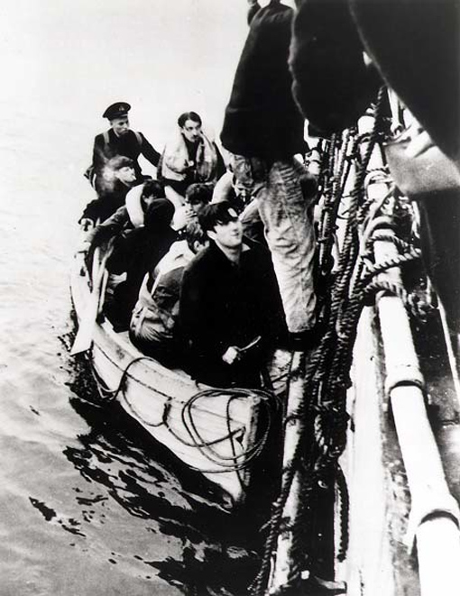 Survivors from U-210 are escorted on board Assiniboine.