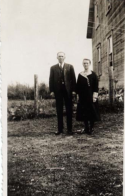 Napoléon Landry and Blandine Matteau by their farm house, 1935.