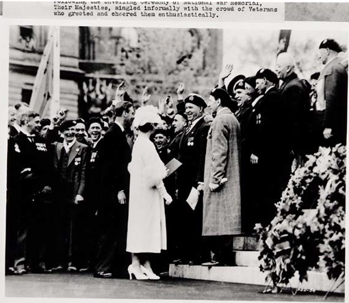 """Their Majesties King George VI and Queen Elizabeth mingle informally with the crowd following the unveiling ceremony of the National War Memorial in Ottawa, 21 May 1939. On this occasion, Governor-General Lord Tweedsmuir wrote to a friend: """"It was wonderful to see old fellows weeping, and crying 'Ay, man, if Hitler could see this.'"""""""