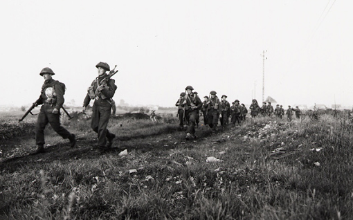 Troops of the Royal Winnipeg Rifles near Ifs, France, 25 July 1944.