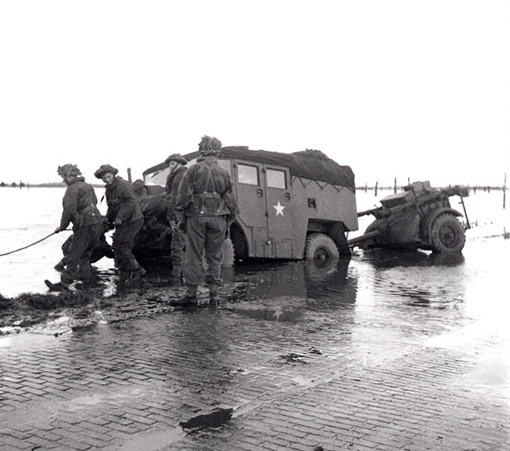 A gun-tractor skidded off the road on the flooded island of Beveland, October 28th, 1944.