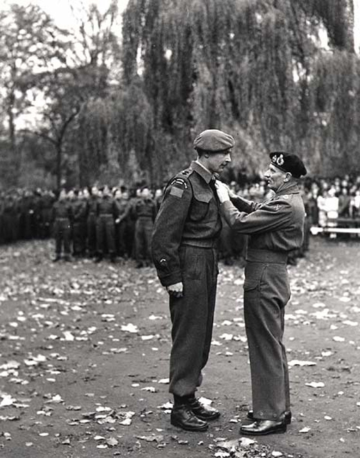 Lt. Col. L. R. Fulton of the Royal Winnipeg Rifles receiving the Distinguished Service Order from Field Marshall Montgomery, Ghent, Belgium, 5 November 1944.