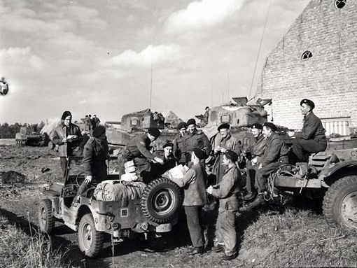 "The mail jeep of the ""A"" Squadron of the Fort Garry Horse making its first stop for deliveries in France or Belgium, 11 October 1944."