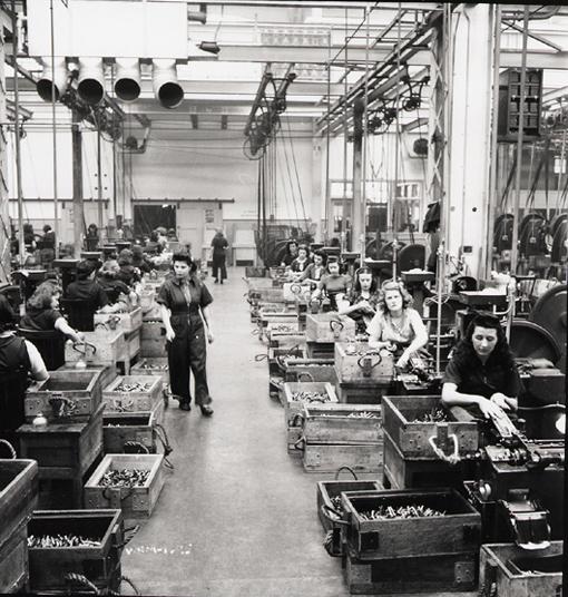 Cartridge production department of the Dominion Arsenal, Saint-Malo, Quebec, April 1942.