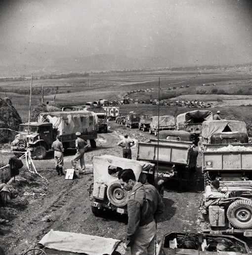 Army Supply vehicles on their way to the front, packed along a track the Engineers ran through the Rapido River flats at the junction of the Rapido and Liri Rivers, near Cassino, Italy, 21 May 1944.