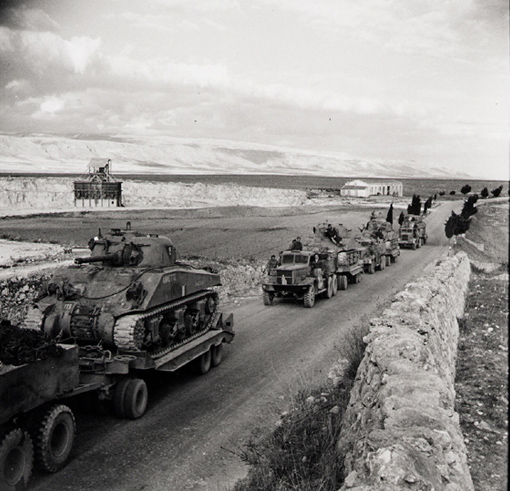 Diamond T tractor-trailer transporters hauling Sherman tanks of the 1st Canadian Army Tank Brigade, Manfredonia, Italy, 12 October 1943.