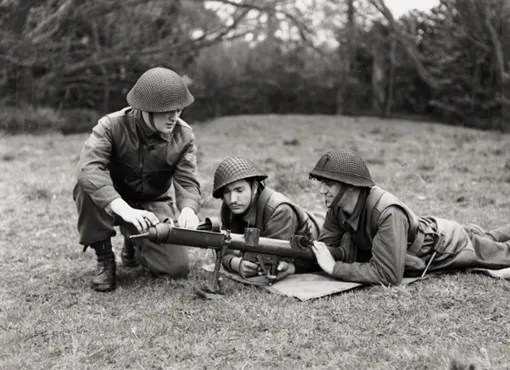 Sergeant D. Wilson, Private J. Brunelle, Private A. Munro, all of Highland Light Infantry battalion, on Piat training, during landing and advancing inland exercise in England, 13 April 1944.
