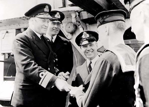 On 29 July 1942, Rear Admiral L.W. Murray is presenting awards to crew members of destroyer HMCS St. Croix, which sank enemy submarine U-90 on 24 July 1942.