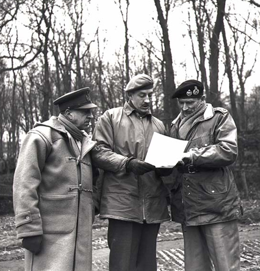 General H.D.G. Crerar (left) and Major-General D.C. Spry (centre) discussing with Marshal Bernard Montgomery (right) before launching Operation Blockbuster, the offensive against the Hochwald Forest, February 23rd, 1945.