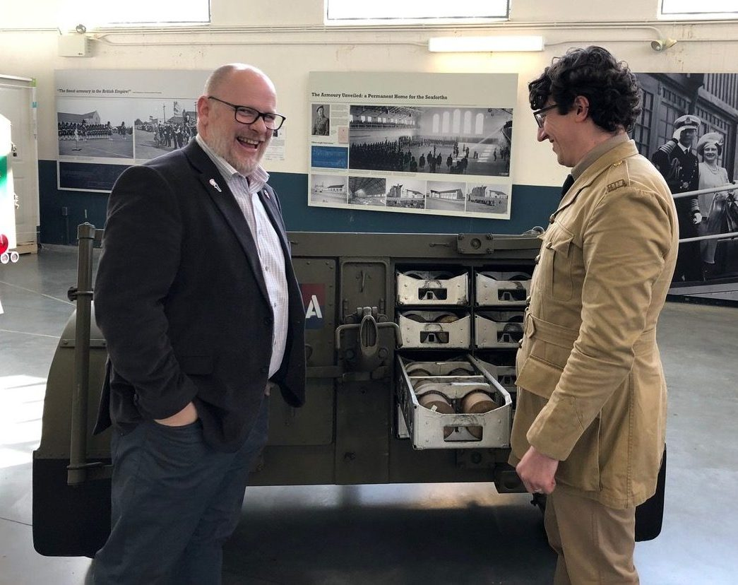 Robert Löken, National Manager, Honours, Awards and Commemoration, Veterans Affairs Canada and Andrew MacRae, member of the 15th Field Artillery Regiment Museum look at a limber used to carry rounds of ammunition for the 25-pounder gun.