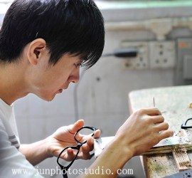 China industrial photographer glasses factory worker