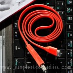 e commerce digital product photographer red Iphone charger