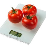 glass kitchen scales with tomato product photography