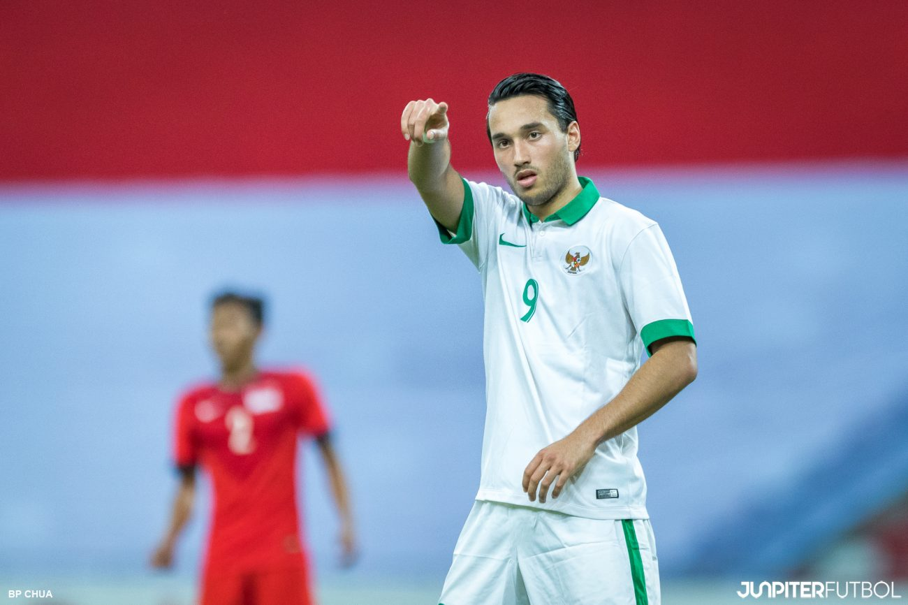 A Long Ball Forward From The Indonesian Team Saw Singapores Defender Struggled To Get It Clear Away Indonesias Number  Ezra Walian Picked Up The Loose