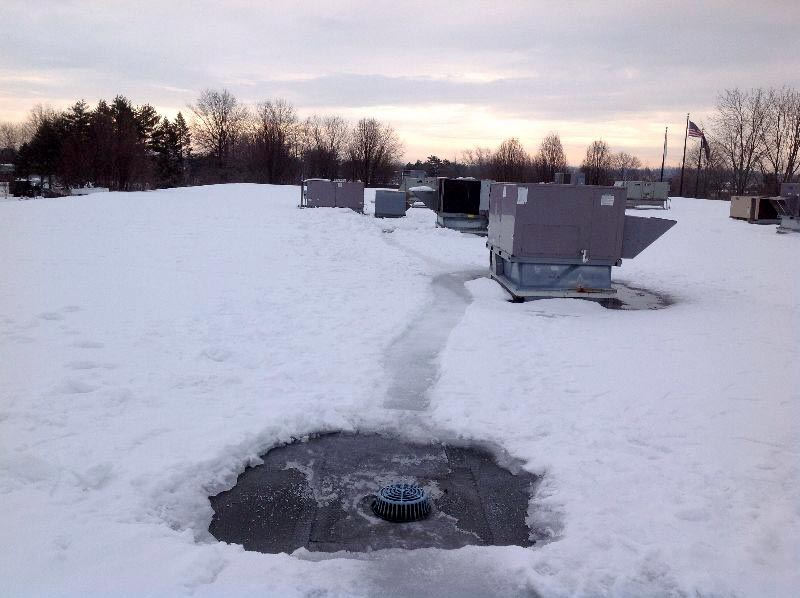 Roof drain cleared of snow