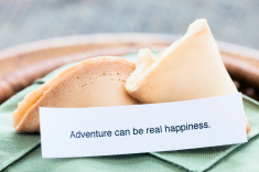 stock-photo-22796581-fortune-cookie-quot-adventure-can-be-real-happiness-quot