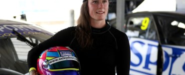 Abbie Eaton stood in front of car, helmet under arm