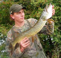 Andrew Kennedy with his first Pike of the season to deadbait