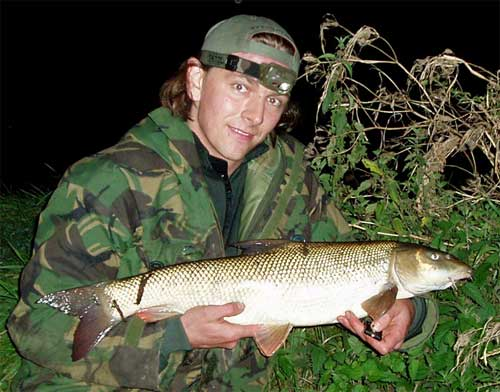 9lb 2oz Barbel caught on Strike One mini boilies>            </p>           <p><i><b>Finally, my first barbel of the season,              which came as a result of making successful changes to my bait and              rigs. The fish weighed 9lb 2oz and was caught using Strike-One mini              boilies.</b></i></p>           <p>I've since had another short evening session where I combined lure              fishing and barbel fishing, using the same tactics and bait which              caught me this first barbel. I was fishing a smaller river, but this              estimated 6lb to 7lb barbel gave me an arm-acheing scrap and took              the best part of ten minutes to land! Again, this was caught using              3 side-hooked Strike-One mini boilies on a Long-Shank Nailer hook,              using the same groundbait mixture in my swimfeeder. I also had another              screaming run, from what I presume was a barbel, but my hooklength              snapped almost immediately, so it must have been damaged in some way.              One thing I did note with both barbel I have caught on the Nailer              hooks, is that they were perfectly hooked, firmly in the corner of              the mouth. There was no chance of them throwing the hook during the              fight, despite them being barbless.</p>           <p><img src=
