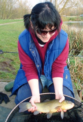Andrew's Friend Freya with her first Tench
