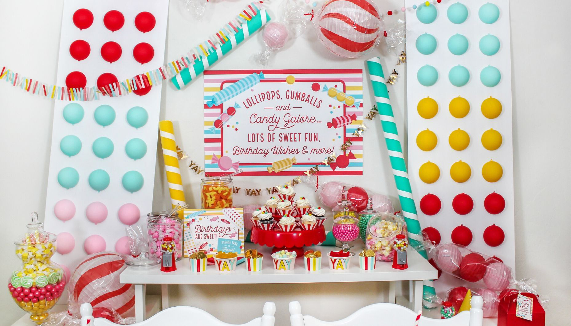 candy themed birthday party, candy party, sweetness overload, candy galore, candy, birthday party, kids birthday, Just Add Confetti, free printables, party printables, birthdays are sweet, candy charcuterie board, oversized candy backdrop, candy backdrop, giant candy buttons, huge candy button backdrop craft, DIY candy crafts, candy buttons, wrapped candies,