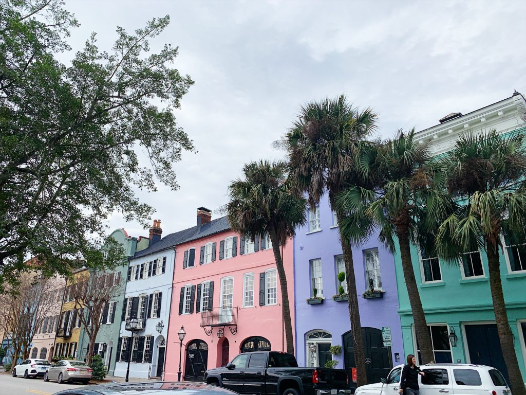 a photo of the pastel-colored houses that line bay street known as rainbow row.