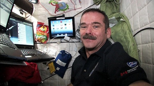 Tweeting in space | Photo courtesy of @Cmdr_Hadfield