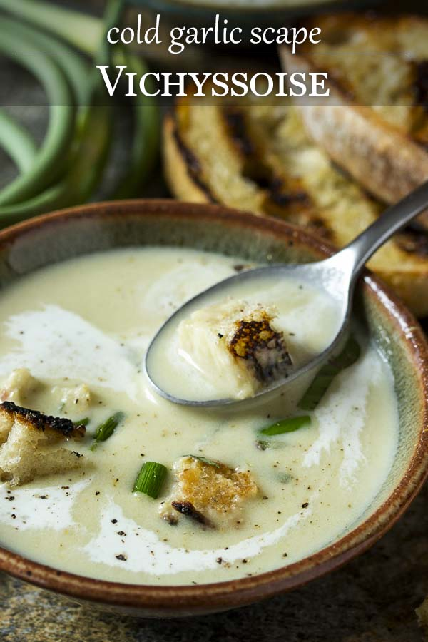 Wondering how to use garlic scapes? A great way to use them is to make a cold garlic scape soup! Perfect for summer and easy to make ahead. Scapes and leeks sauteed in butter and simmered with potatoes make a great twist on the classic French vichyssoise. | justalittlebitofbacon.com #summerrecipes #souprecipes #garlicscapes #frenchrecipes #vichyssoise #coldsoup