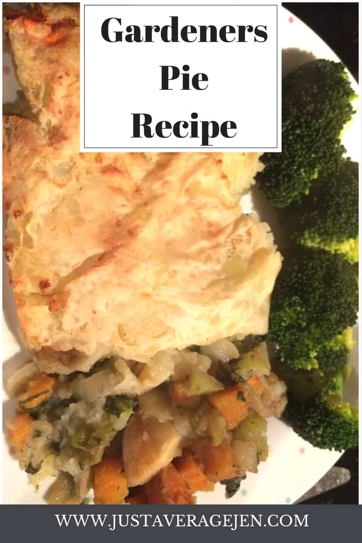 mixed vegetables under a mashed potato topping on a white plate served with brocolli
