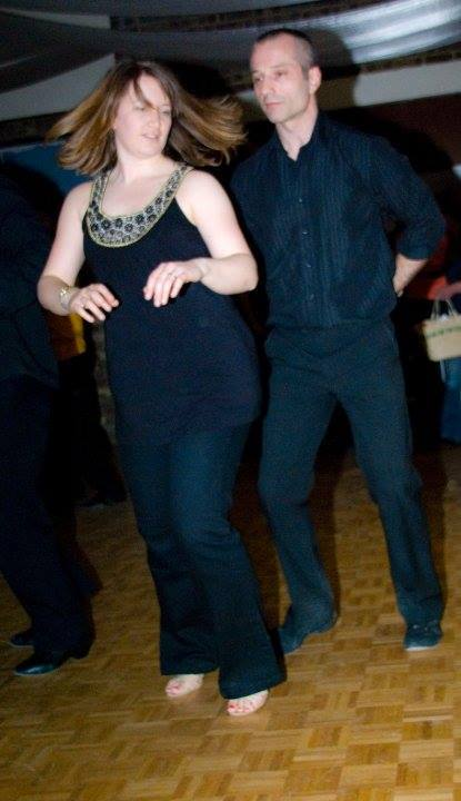 a couple dressed in black dancing