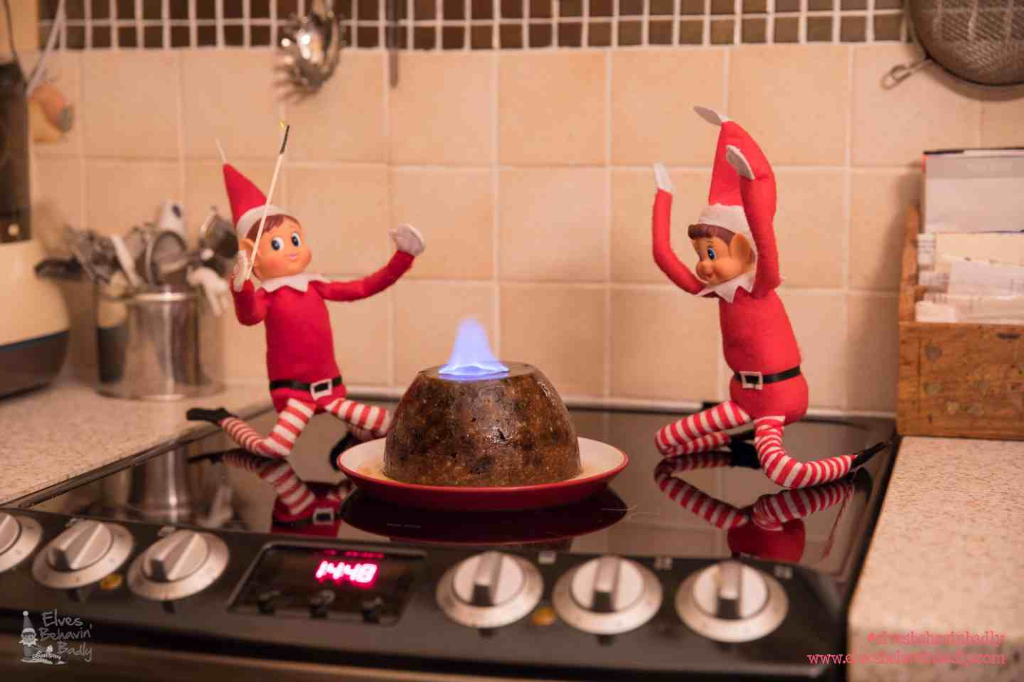 elves with a flaming christmas pudding