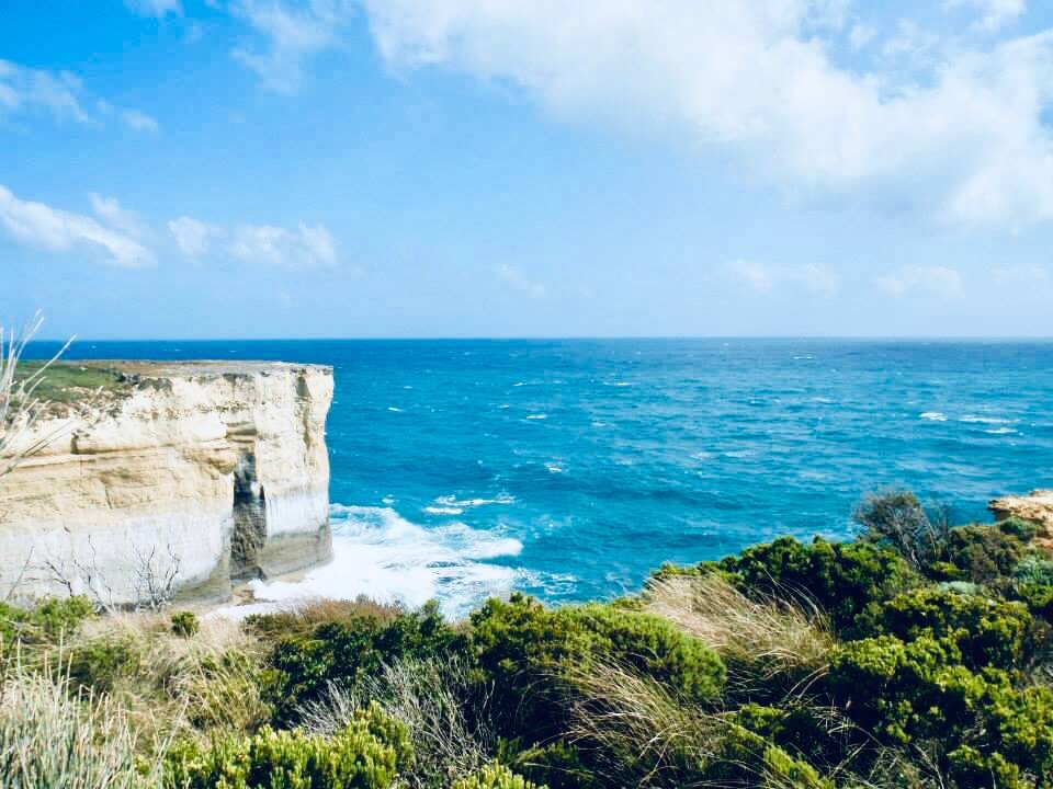 Standing at a viewing platform, showing the cliffs and the ocean. 11 things to do in Melbourne