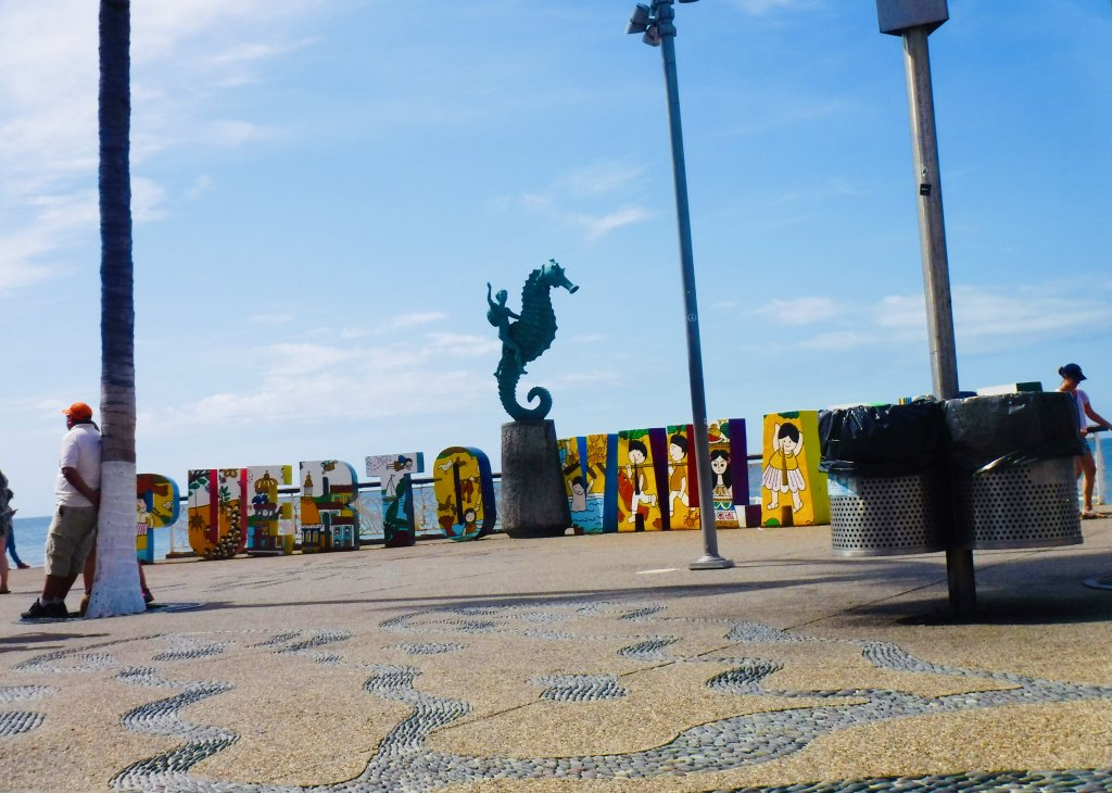 The famous Puerto Vallarta sign on the Malecon, with the seahorse statue