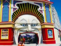Me standing in front of the entrance to Luna Park. 11 things to do in melbourne