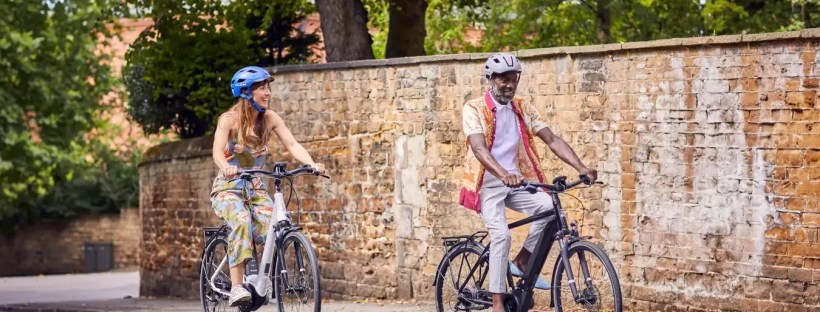 Woman and man riding bicycles - cycling holiday