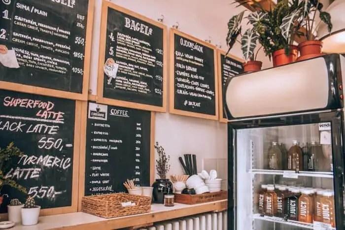 The menu and fridge at Juicy & Budapest Bagel
