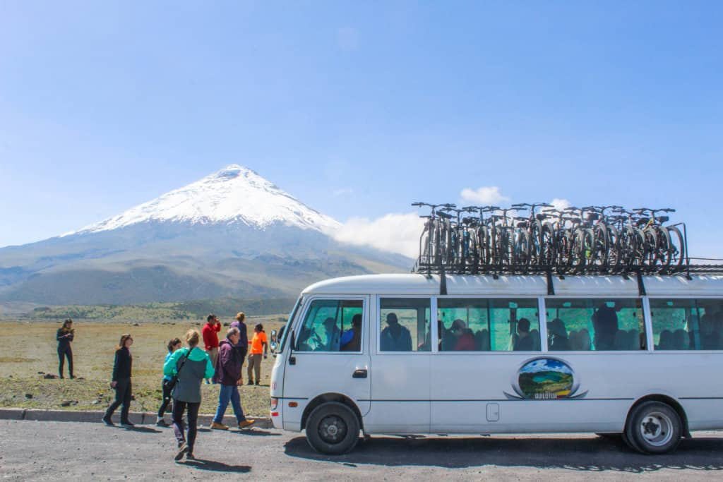 tour group and van in front of cotopaxi