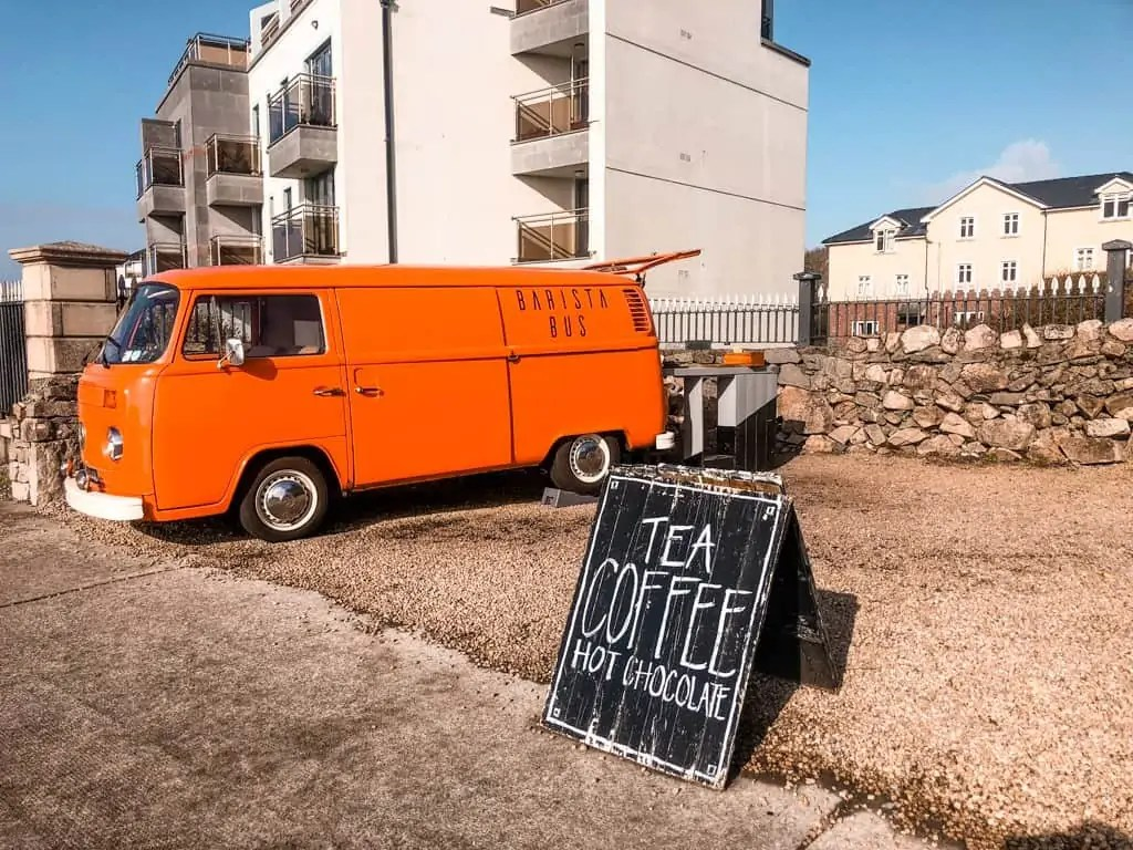 Orange bus with a sign for tea and coffee